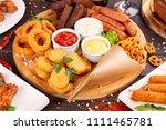 beer snacks close up. grilled... | Shutterstock . vector #1111465781