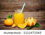 orange juice in glass with... | Shutterstock . vector #1111471565