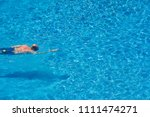 man swimming in a pool in summer | Shutterstock . vector #1111474271