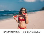 young woman in red bikini with... | Shutterstock . vector #1111478669