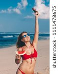 young woman in red bikini with... | Shutterstock . vector #1111478675