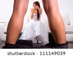 Bride laughing from the groom striptease - stock photo