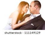 Bride and groom studio portrait over white background - stock photo