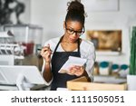 shop assistant taking order on... | Shutterstock . vector #1111505051