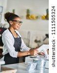 friendly african american shop... | Shutterstock . vector #1111505324