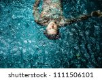tattooed man in the pool in the ... | Shutterstock . vector #1111506101