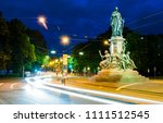 Small photo of Trams whiz by the Max Monument at night; A monument commemorating King Maximilian II of Bavaria.
