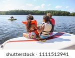 people sitting on a boat and... | Shutterstock . vector #1111512941