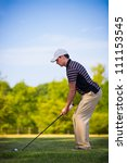 Young Golfer Swing Club under Summer Blue Sky - stock photo