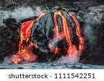 Small photo of Hawaii lava flow entering the ocean on Big Island from Kilauea volcano. Volcanic eruption fissure view from water. Red molten lava.
