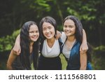 happy teenage friends smiling... | Shutterstock . vector #1111568801