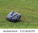 black robot lawn mower works on ... | Shutterstock . vector #1111626155