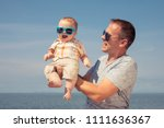 father and baby son playing on... | Shutterstock . vector #1111636367