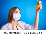 girl in a medical suit holds a ... | Shutterstock . vector #1111657355