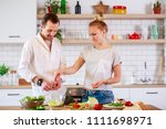 image of man and woman cooking... | Shutterstock . vector #1111698971