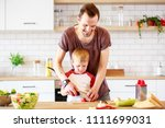 image of man with son cooking... | Shutterstock . vector #1111699031