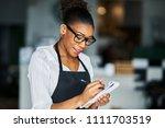 african american waitress... | Shutterstock . vector #1111703519