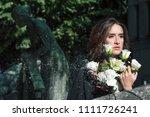 sad woman portrait holding... | Shutterstock . vector #1111726241