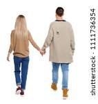 back view of going couple.... | Shutterstock . vector #1111736354