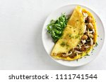 omelette stuffed with mushrooms ... | Shutterstock . vector #1111741544