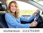 smiling woman in the car on a... | Shutterstock . vector #1111751345