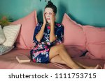 beautiful young lady in a navy... | Shutterstock . vector #1111753715