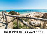 wooden fence by the shore in... | Shutterstock . vector #1111754474
