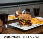 sticked cheeseburger with fri... | Shutterstock . vector #1111779761