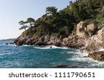 sea waves crashing against the... | Shutterstock . vector #1111790651