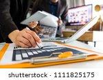 business team meeting present... | Shutterstock . vector #1111825175