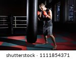 male boxer boxing in punching... | Shutterstock . vector #1111854371