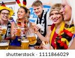football fans watching a game... | Shutterstock . vector #1111866029
