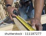 close up of a man measuring...