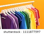 rack with rainbow clothes on... | Shutterstock . vector #1111877597