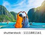 happy couple traveler doing... | Shutterstock . vector #1111881161