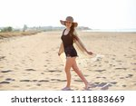 beautiful young woman in straw... | Shutterstock . vector #1111883669