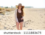 beautiful young woman in straw... | Shutterstock . vector #1111883675
