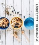 colorful bowls with morning... | Shutterstock . vector #1111938095