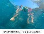 little boy and girl feet in... | Shutterstock . vector #1111938284