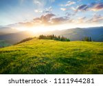 sunset in the mountain valley.... | Shutterstock . vector #1111944281