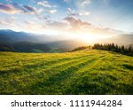 sunset in the mountain valley.... | Shutterstock . vector #1111944284