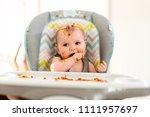 little baby eating her dinner... | Shutterstock . vector #1111957697