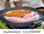 korean style barbecue pork grill | Shutterstock . vector #1111958495