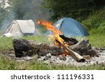 Camp Fire And Two Tents In The...