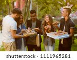 friends sharing slices of pizza ... | Shutterstock . vector #1111965281