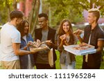 happy students are eating pizza ... | Shutterstock . vector #1111965284