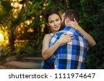 portrait of a happy couple... | Shutterstock . vector #1111974647