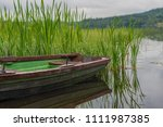 a small rowing boat  by the... | Shutterstock . vector #1111987385