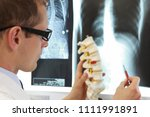 doctor with  model  of spine... | Shutterstock . vector #1111991891