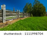 wooden fence in green grass... | Shutterstock . vector #1111998704